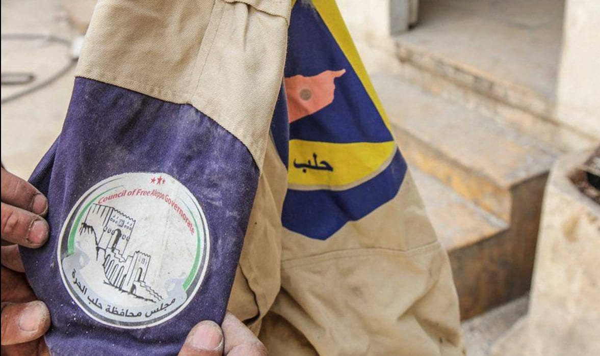(Photo: Council of Free Aleppo Government on a White Helmets uniform)
