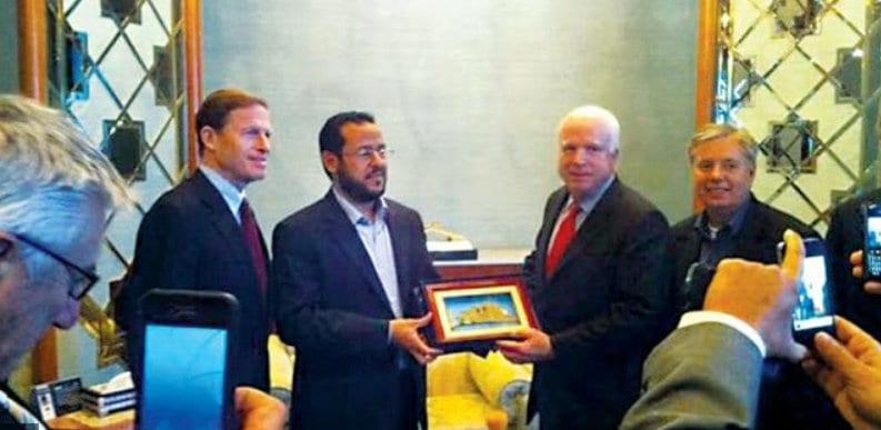 Al Qaida affiliate, Abdelhakim Belhadj with John McCain Herland Report