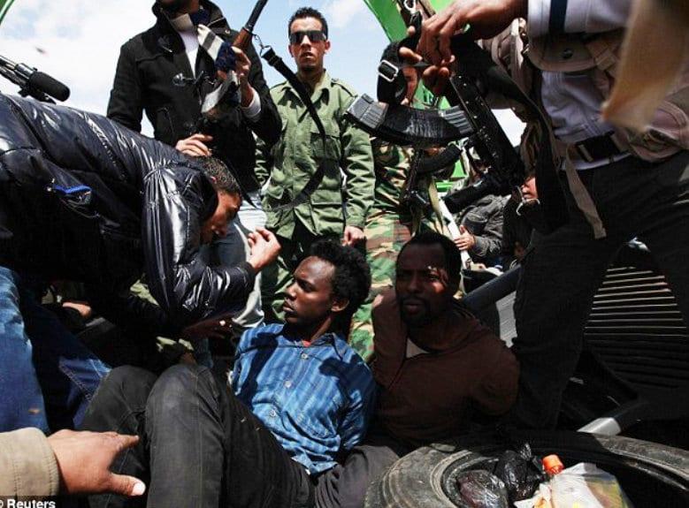 new civil war Libya Libya blacks atrocities. Ill.