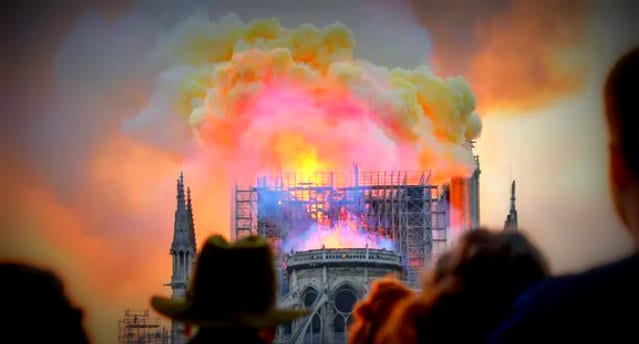 notre dame burning arson vandalism attack christian heritage assault getty herland report